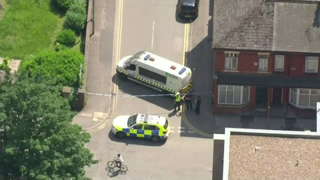 former friend of salman abedi says that he could have been stopped / police investigation continues ext police vehicles parked at entrance to sealed... - stationery stock videos & royalty-free footage