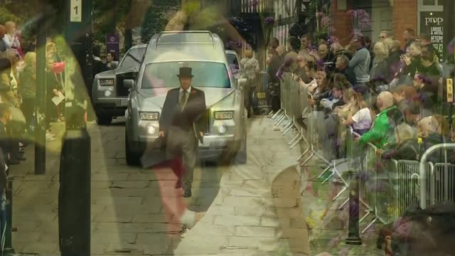 funeral of saffie roussos ext andrew roussos and others carrying coffin out of cathedral girls laying flowers hearse along past applauding people... - hearse stock videos & royalty-free footage