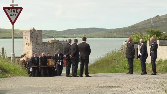 Funeral of victim Eilidh MacLeod SCOTLAND Outer Hebrides Barra EXT Various of bagpiper leading funeral procession for Manchester Arena suicide bomb...