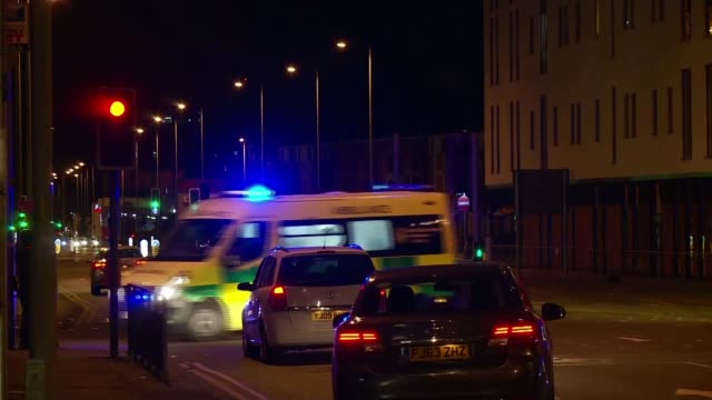 hospitals still treating 59 injured by bomb england manchester ambulance along road with blue flashing lights and sirens sot police vehicles along on... - manchester england stock videos and b-roll footage
