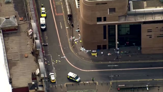 manchester arena attack inquiry: names of 22 victims read out as inquiry opens; r230517010 / england: manchester: ext air view / aerial police cars... - manchester arena stock videos & royalty-free footage