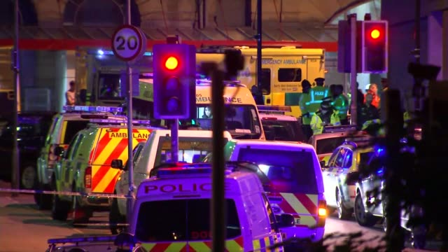 itv news special 0925 1025 manchester police and ambulances at scene soldiers next to 'rlc bomb disposal' vehicle - manchester arena stock videos & royalty-free footage