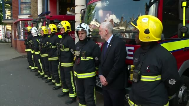 Jeremy Corbyn minute's silence ENGLAND London Islington EXT Jeremy Corbyn arrival at Islington Fire Station / Jeremy Corbyn standing with...