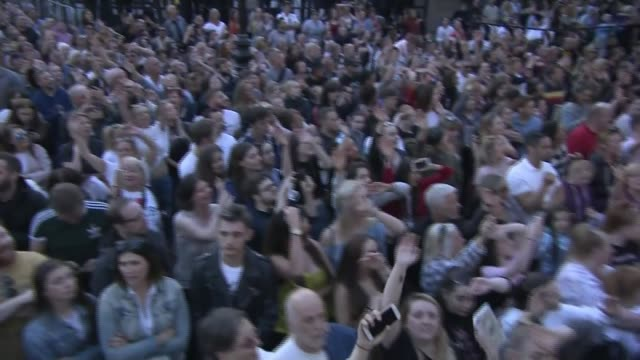 one year anniversary england manchester albert square ext various of choir and band performing song on stage at manchester together mass singalong... - singing stock videos & royalty-free footage