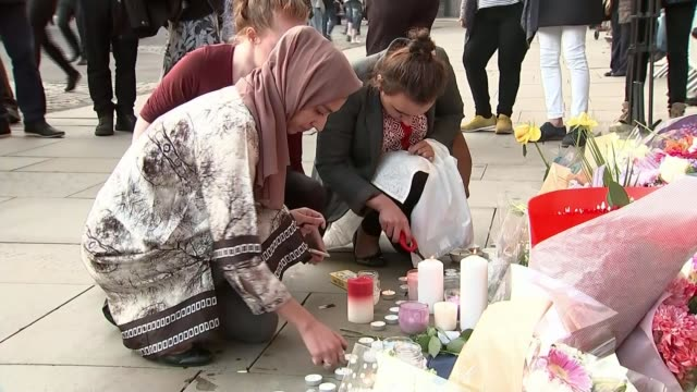 Manchester Arena Attack report criticises some media T23051702 / TX EXT Manchester Arena Attack aftermath Women including one wearing headscarf...