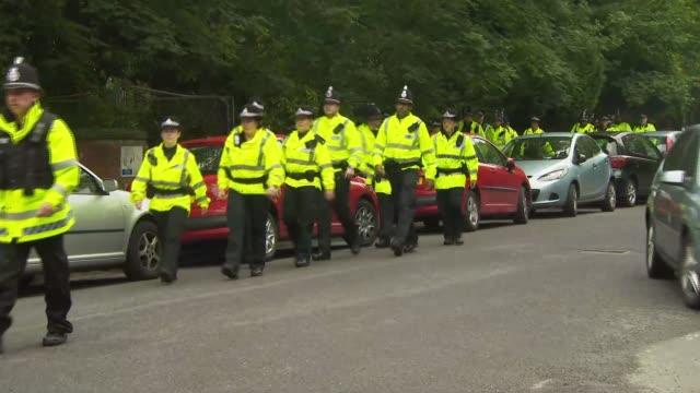 Rusholme evacuation and police ENGLAND Manchester Rusholme EXT GVs police at cordon evacuating people