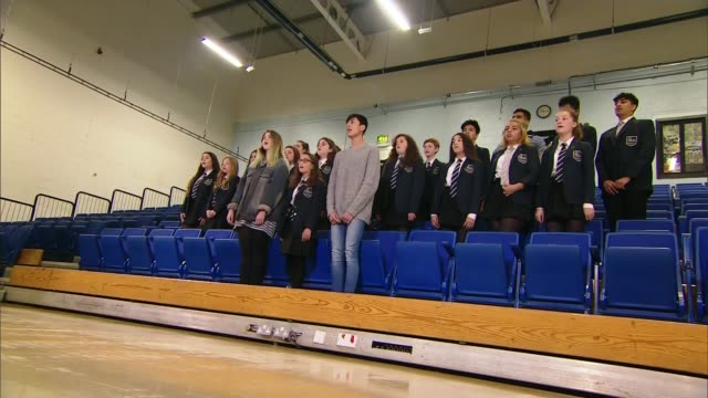 manchester arena attack: school choir prepare to take part in benefit concert; england: manchester: parrs wood high school: int **music heard sot**... - choir stock videos & royalty-free footage