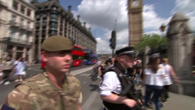 security stepped up across uk england london westminster parliament square ext various of armed police and soldiers around westminster palace - armed police forces stock videos & royalty-free footage