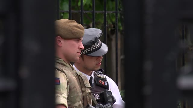 security still high in london england london westminster ext various of soldiers and armed police guarding houses of parliament / downing street sign... - horse guards parade stock videos and b-roll footage