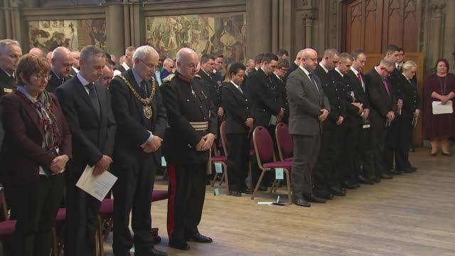 Service remembers victims and honours those who tried to help ENGLAND Manchester INT Various of people attending service to remember the victims of...