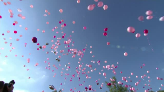 Tributes to Manchester victims ENGLAND Greater Manchester Oldham EXT Pink balloons released into sky by crowd attending vigil in memory of victims of...