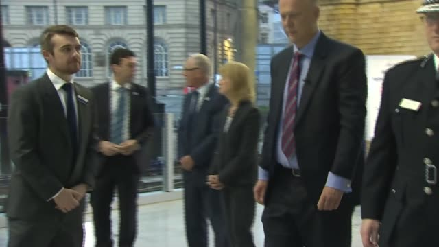 Victoria Station reopens ENGLAND Manchester Manchester Victoria Station INT Gvs Chris Grayling and Andy Burnham lay wreaths inside station / Chief...