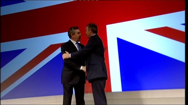 lib bridgewater hall photography ** brown shaking hands with tony blair in front of giant union flag at labour party conference - bridgewater hall stock videos & royalty-free footage
