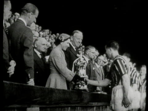 manchester city captain roy paul receives trophy from queen elizabeth ii as prince philip looks on, birmingham city vs manchester city, 1956 fa cup... - 1956 stock-videos und b-roll-filmmaterial