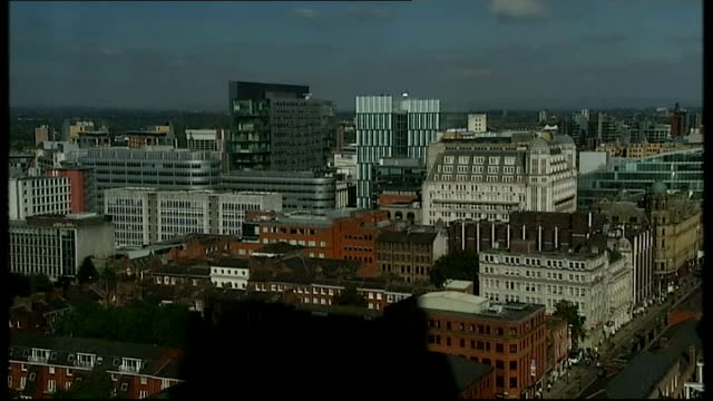 vídeos de stock e filmes b-roll de manchester ext various high angle shots of manchester city centre skyline and buildings on sunny day including office blocks and apartments... - town hall