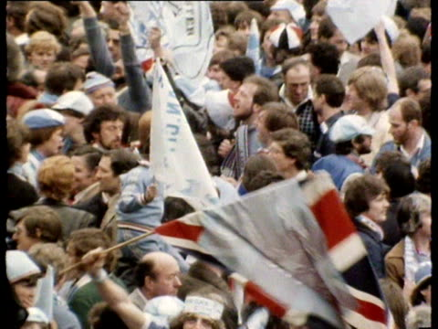 stockvideo's en b-roll-footage met manchester city fans gather and wave flags outside wembley stadium prior to the fa cup final match against tottenham hotspur - fa cup