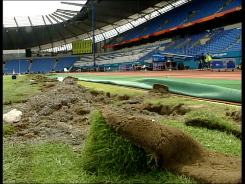 commonwealth games: closing ceremony; itn day cms hole in turf at edge of stadium lms workers dismantling gantry in stadium grass dug up at side of... - commonwealth games stock videos & royalty-free footage