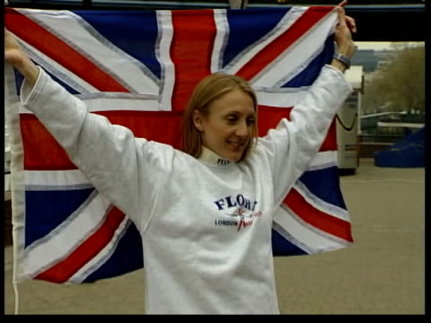 commonwealth games; lib london: paula radcliffe posing with union flag after winning london marathon - commonwealth games stock videos & royalty-free footage