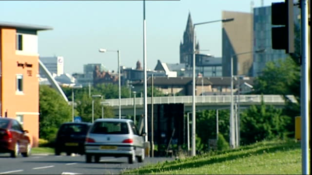 manchester congestion charge scheme given goahead manchester traffic along main road into manchester city centre with hulme arch and beetham tower in... - main tower stock videos and b-roll footage