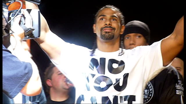 manchester photography** david haye onto stage at weighin wearing tshirt no you can't audley harrison onto stage at weighin - david haye stock videos and b-roll footage