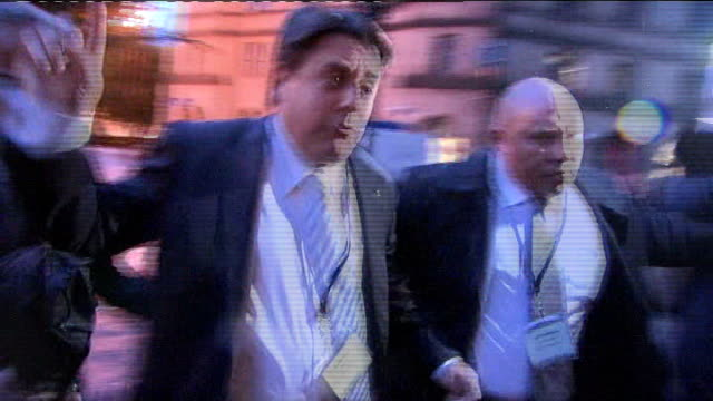 manchester manchester town hall photography** nick griffin with police officers arriving at back entrance of town hall for the european election... - griffin stock videos & royalty-free footage