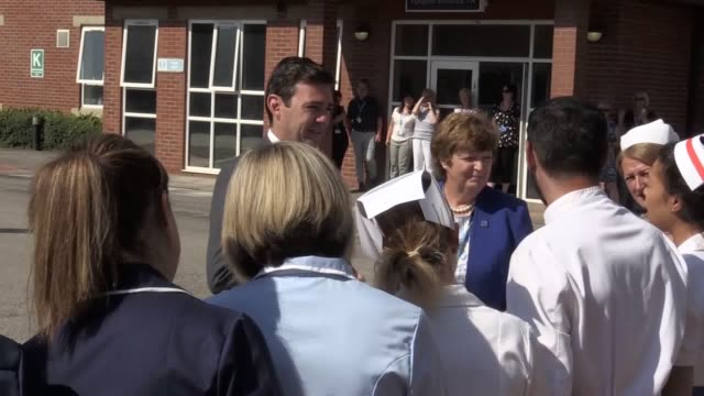 manchester mayor andy burnham visits trafford general the birth place of the nhs when nye bevan visited the hospital on july 5th 1948 he met with... - nhs stock videos & royalty-free footage
