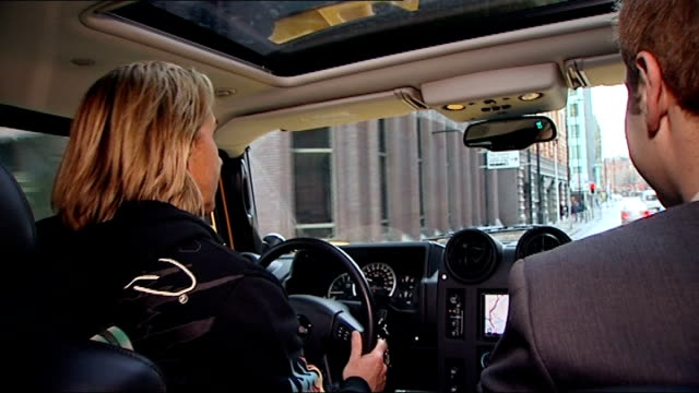 manchester nik speakman and reporter along to hummer low angle view hummer with personalised number plate engine started sot nik speakman interview... - hummer stock-videos und b-roll-filmmaterial