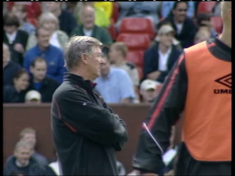 Old Trafford EXT Manchester United Manager Sir Alex Ferguson watching training session Hertfordshire Arsenal Manager Arsene Wenger and Assistant...
