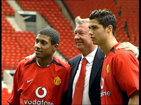 manchester: old trafford: jose alvalade stadium: ext manchester united manager sir alex ferguson posing for photocall with new signings cristiano... - manchester england stock videos & royalty-free footage