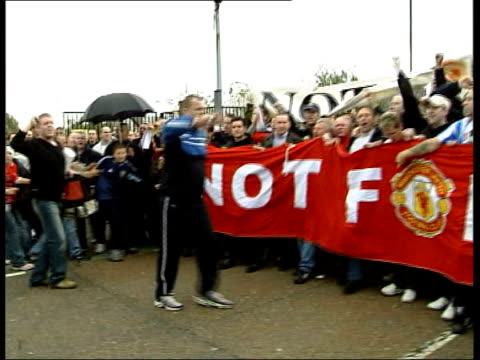 Manchester Old Trafford stadium Protestors holding 'Not For $a£e' TILT UP LMS Angry Manchester United fans carrying long red banner reading 'Not for...