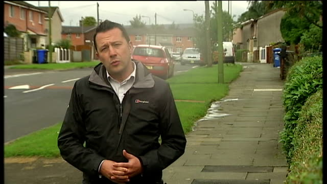 dale cregan remanded in custody hattersley reporter to camera fields seen beyond housing estate window tilt down metal police cordon surrounding... - hattersley stock videos and b-roll footage