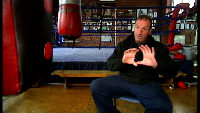 man charged with murders boxing gloves on floor and man training in background reporter asking question sot joe pennington interview sot hattersley... - hattersley stock videos and b-roll footage