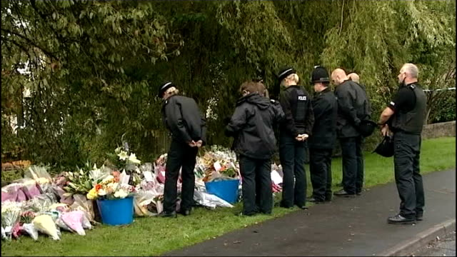 man charged with murders england greater manchester hattersley ext group of police officers two carrying floral tributes along near scene where two... - hattersley stock videos and b-roll footage