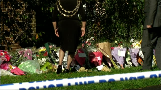 tributes to pcs nicola hughes and fiona bone england manchester hattersley ext police officers along beside floral tributes / car along and brenda... - book signing stock videos & royalty-free footage