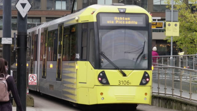 manchester street scenes as the area faces being put into the highest level of coronavirus cases due to rising levels of infection - tram stock videos & royalty-free footage