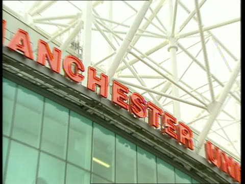 manchester united and new york yankees deal; manchester united and new york yankees deal; itn england: manchester: old trafford ext manchester... - megastore stock videos & royalty-free footage