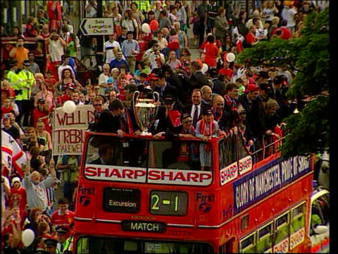 manchester united announce fa cup withdrawal lib bus carrying manchester united players making way thru crowded streets in city centre during victory... - parade stock videos & royalty-free footage