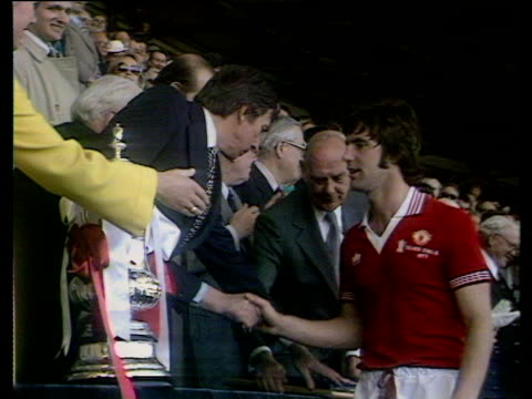 manchester united captain martin buchan lifts fa cup trophy, presented by the duchess of kent, liverpool fc vs manchester united, 1977 fa cup final,... - picking up stock videos & royalty-free footage