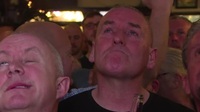 Manchester United fans express sadness and solidarity as they gather in a pub to watch their team take on Ajax just days after a suicide bombing left...