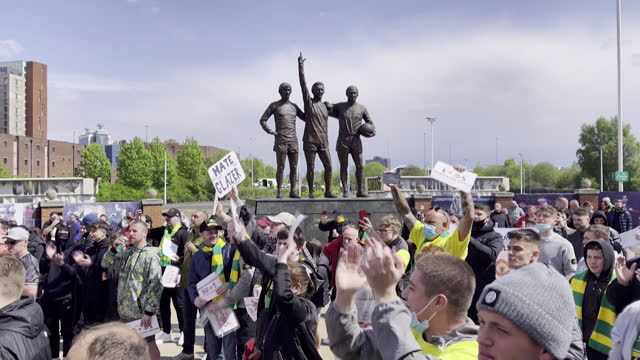 manchester united fans protesting outside old trafford stadium against owners, the glazer family, over long term resentment and recent attempt to... - owner stock videos & royalty-free footage