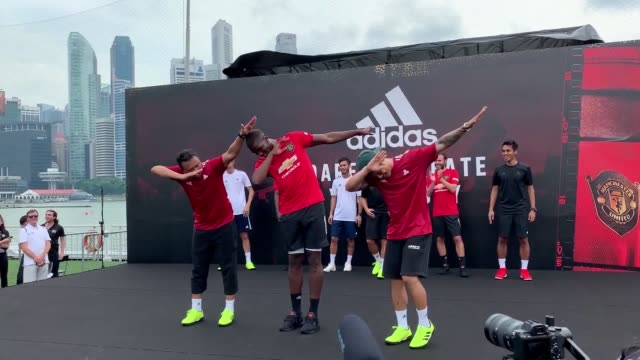 manchester united hold an event in singapore with their kit sponsor, adidas. juan mata, aaron wan-bissaka and paul pogba kickabout and meet fans... - football strip stock videos & royalty-free footage