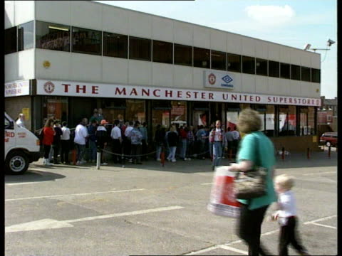Manchester United Premier League title ENGLAND Manchester CMS Customer in Man Utd supporters shop MS Ditto MS Customers browse through shop LS Line...
