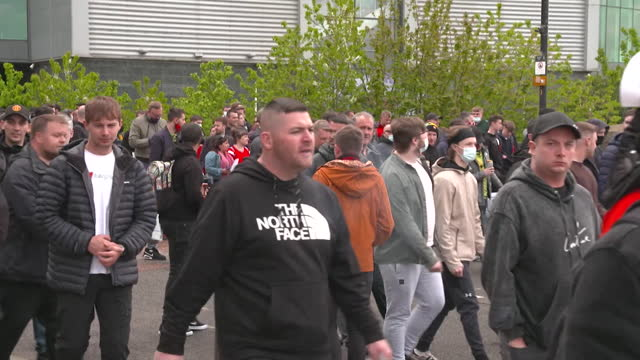 manchester united supporters protesting the ownership of the glazer family outside old trafford - information medium stock videos & royalty-free footage