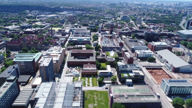 manchester university district 4k aerial video - manchester england stock videos & royalty-free footage