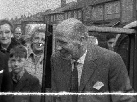 manchester utd manager home following air crash england manchester zoom in as matt busby gets out of car cs past camera hobbling with 2 sticks ms... - 1958 stock videos and b-roll footage