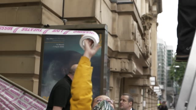manchester's royal exchange theatre being wrapped in tape to highlight the economic effect of coronavirus on the arts industry - overexposed stock videos & royalty-free footage
