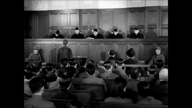manchuria courthouse building ws japanese court judges ms prisoner bowing talking ms japanese judge at bench flipping through book law justice court... - court stock videos & royalty-free footage