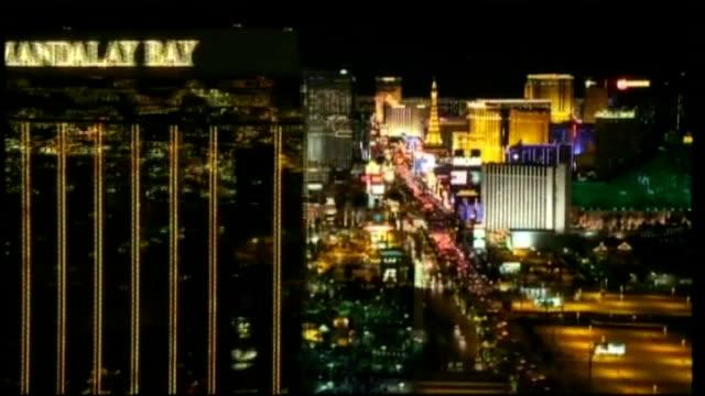 mandalay bay hotel and vegas strip lit up at night - mandalay bay resort and casino stock videos and b-roll footage