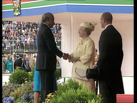 mandela state visit london tms gun salute being fired sot horseguards parade mandela up steps of podium and shakes with queen zoom in as joined by... - holding poster stock videos & royalty-free footage