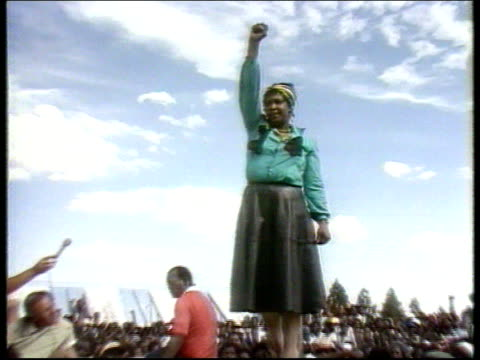 Mandelas marriage rift EXT LACMS Winnie giving clenched fist sign at rally CMS Nelson and Winnie Mandela casually dressed giving clenched fist sign